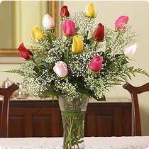 Balgat Ankaradaki çiçekçiler  renkli gül 11 adet çiçekçi den cam yada mika vazo tanzimi