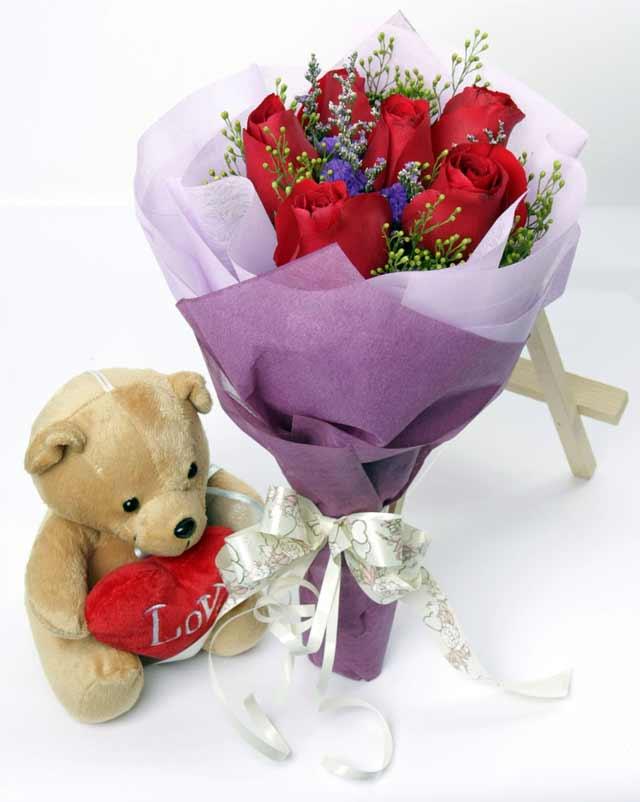 oyuncak ve 7 adet kirmizi gül buketi  Ankara 14 şubat sevgililer günü çiçek